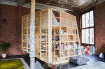 Atelier Antipode Independant furniture piece in a loft, used as a sleeping area, dressing and book storage