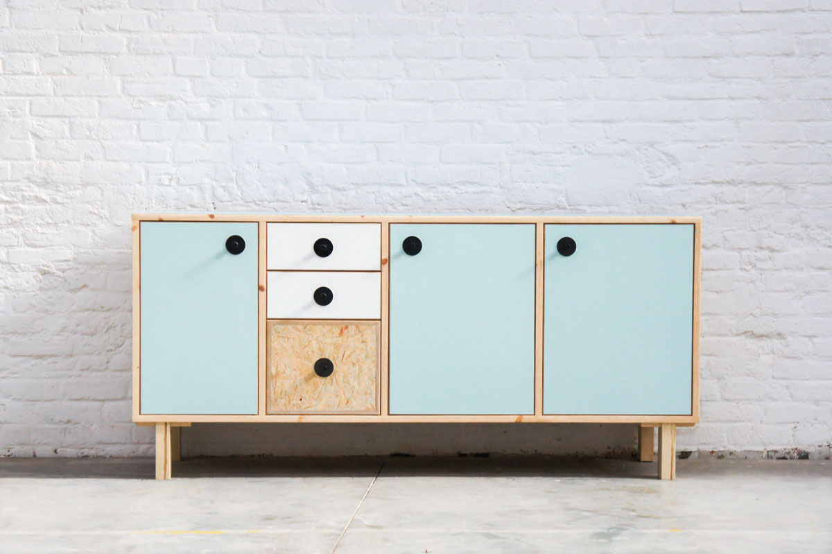 Credenza in mint green and vanilla laminate, pine wood, and OSB with recycled black door knobs by Atelier Antipode