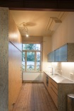 Atelier Antipode | OSB furniture in Brussels renovation residence