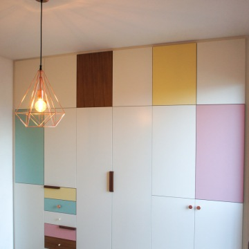 Atelier Antipode   pastel patchwork   wardrobe of white laquered doors matched with pastel laminate and oak, handmade meranti handles and copper cabinet knobs by Schoolhouse Electric