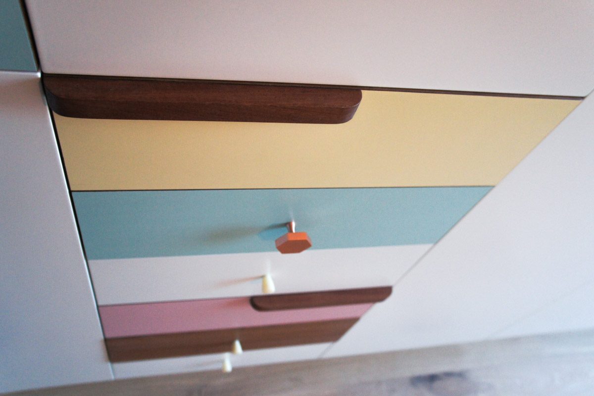 Atelier Antipode | pastel patchwork | wardrobe of white laquered doors matched with pastel laminate and oak, handmade meranti handles and copper cabinet knobs by Schoolhouse Electric